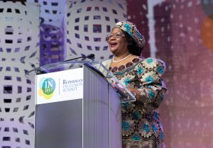 Joyce Banda behind the Summit Podium, giving a speech.