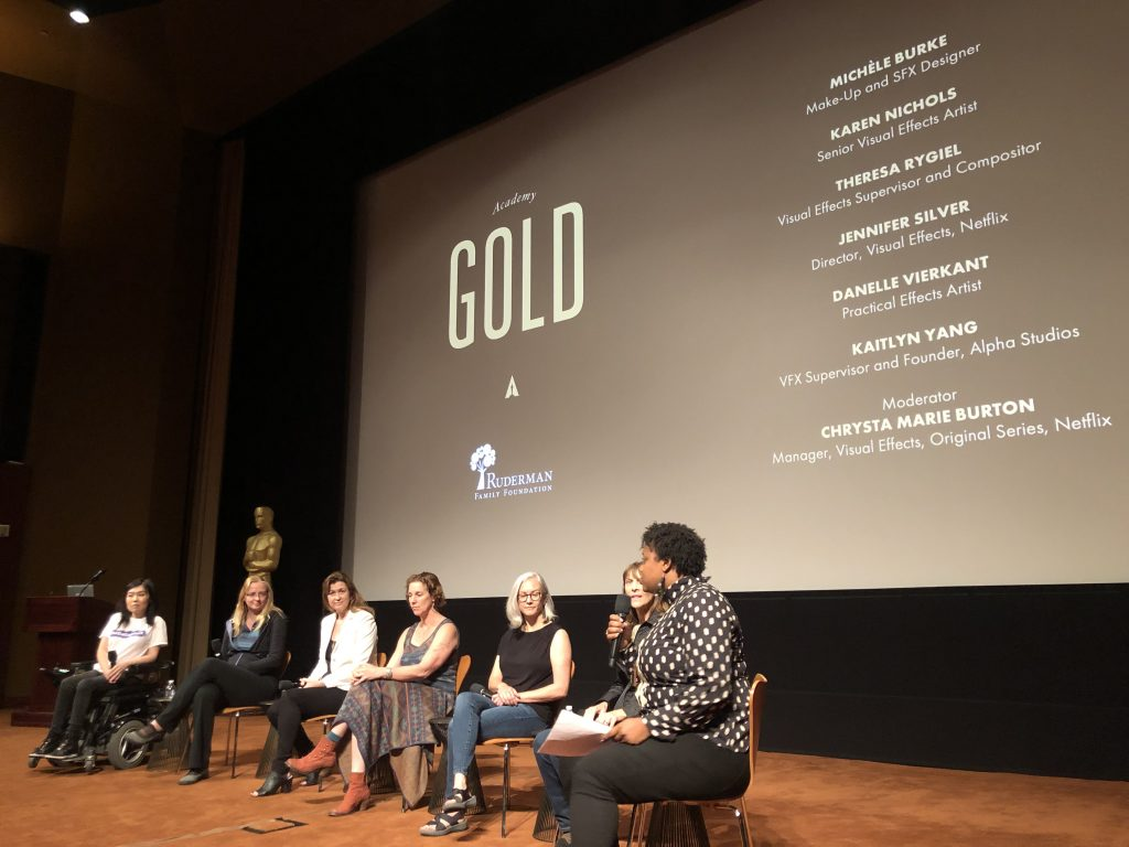 Pictured: the all-female visual effects panel at the Academy Gold program last week. All seven women are sitting on chairs on the stage with their names (Michele Burke, Karen Nichols, Theresa Rygiel, Jennier Silver, Danelle Vierkant, Kaitlyn Yang (far left), and Chrysta Marie Burton (far right)) - behind them.